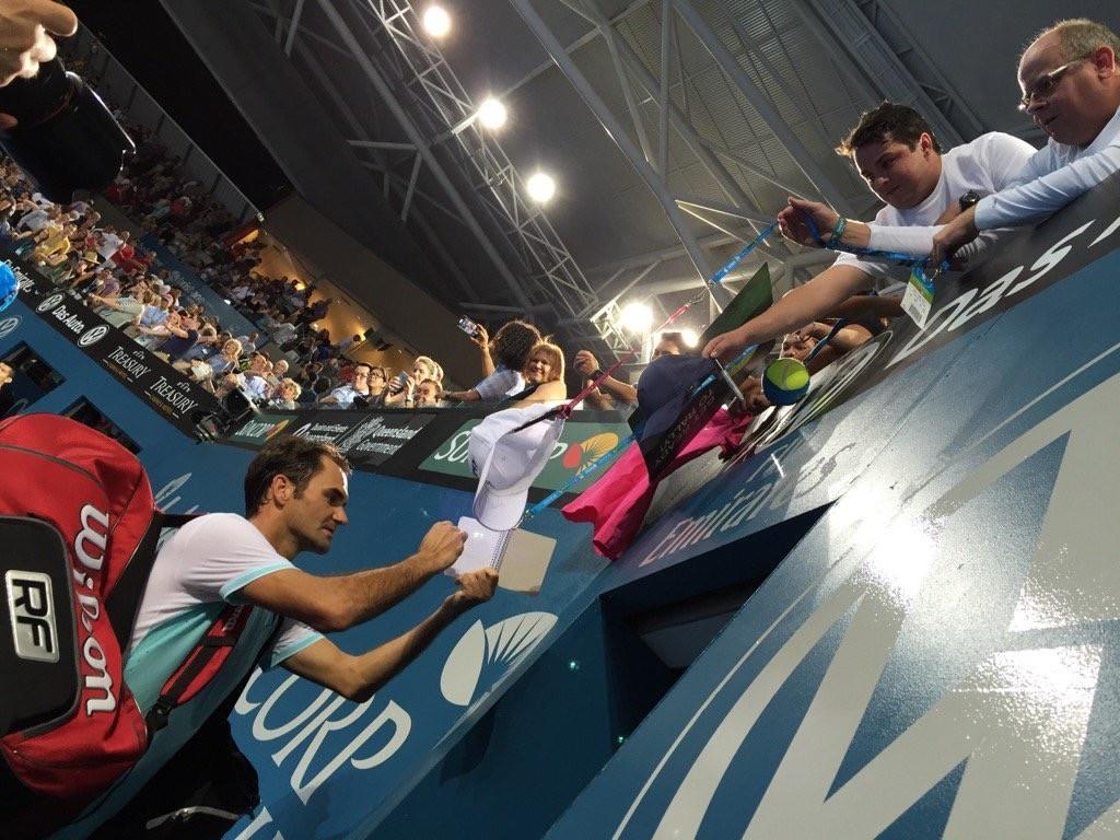 Roger Federer signs autographs for fans at the 2016 Brisbane International